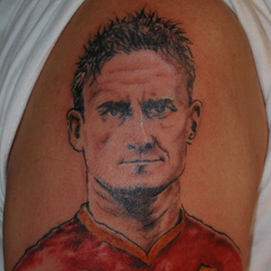 Tatuaggio viso Totti